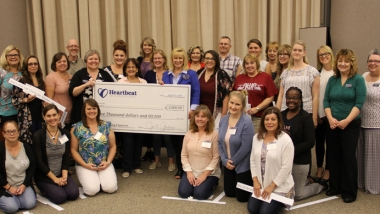 Heartbeat International team members with recipients of the twenty $5,000 grants presented at Pregnancy Help Institute this summer