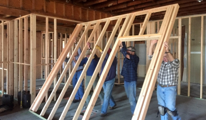 A work crew organized by a pastor who serves as board president framing the inside of Pregnancy Care Center's new location.