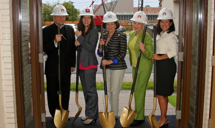 Archbishop Gregory Aymond, Dr. Susan Caldwell, Gayle Benson, Phyllis Taylor, Angie Thomas (left to right) break ground on the new location a parking lot away from Planned Parenthood