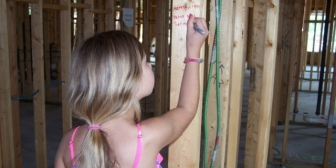 """Hope,"" a fitting name for a girl whose brother was rescued from abortion by Options for Life, gave $2.38 for the center's new location. She's writing Matt. 19:14 - ""Let the children come to me"" during the remodel"