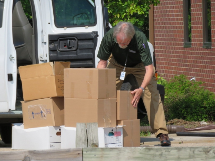 Planned Parenthood of the Heartland's Brant Morgan collects boxes of personal health information May 16 that Planned Parenthood knowingly left unattended for 10 days.