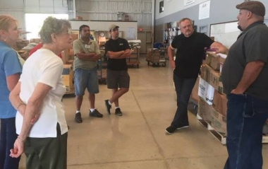 Joseph Pardo (right) prepares a supply run to Puerto Rico following Hurricane Maria.
