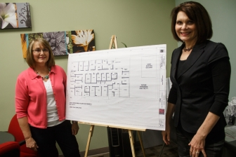 Fallbrook Pregnancy Resource Center executive director Carolyn Koole, left, and Fallbrook Pregnancy Resource Center brand manager and Mission Continues fellow Rhonda Schlumpberger, with blueprints outlining the center's future expansion plans.
