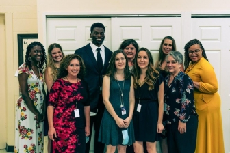 Benjamin Watson with New Hope Family Services staff