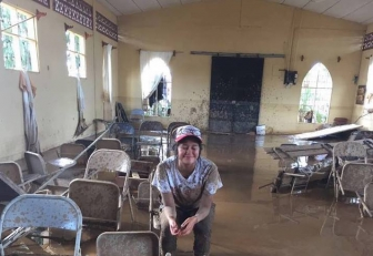 Esthercita sits in the church and pregnancy center in Upala, Costa Rica, which was destroyed last week by Hurricane Otto.
