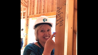 "Lenna Smith, CEO of Piedmont Women's Center in Greenville, South Carolina, points to the first words written on the building's walls: ""This ministry and this building are for God's glory."""