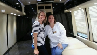 Jennifer Gunderman, APRC's Board President (left) with Theresa Suffern, APRC's Nurse Manager, in a Save the Storks bus, which they hope to bring to Little Rock by Dec. 2017.