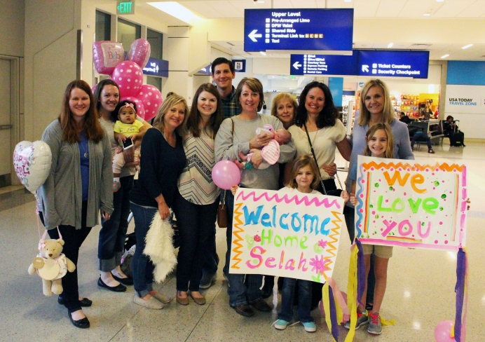 Cameron and Alisha's family and friends greet their family of three for the first time in early February.