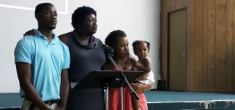 Rhonda Darville (second from left) joins family sharing their testimony at GodParent Center's opening event June 2