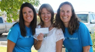 Vera Ulibarri and Carrie Chalverus present a check for $4,500 to Jane Richardson of the Pregnancy Help Center.