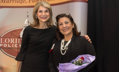 Martha Avila, executive director at Heartbeat of Miami, with Pam Tebow at a banquet honoring pregnancy centers throughout Florida.