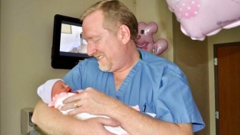 An OB/GYN for over two decades, Dr. Brent Boles holds a child he delivered. Boles has been involved in recent statewide efforts in Tennessee to protect women and children from the abortion industry.