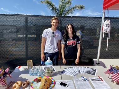Pietro Lanza and Madison Zeigler at their pro-life display during their high school's homecoming football game
