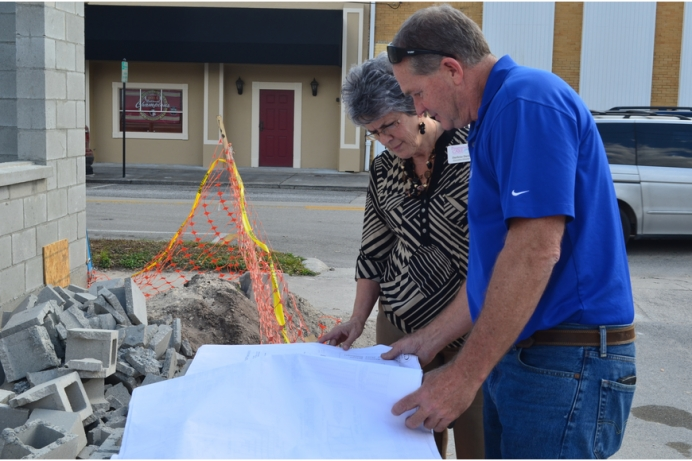 Darlene Davis and Clayton Jenkins look over plans for the center's expansion.
