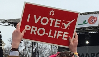 A pro-life supporter displays a Susan B. Anthony List get-out-the-pro-life-vote sign during the 2020 March for Life rally