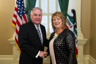 Kristi Burkhart receiving Woman of the Year honors from Calif. Asm. Jim Patterson