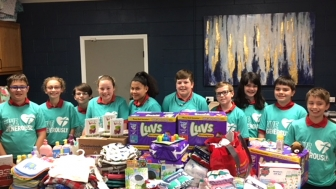 Fifth graders at at St. John Catholic School in Russellville, Arkansas make the most out of a few hundred dollars by helping a local pregnancy help center.
