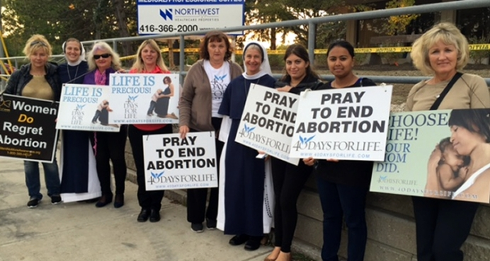 Women praying for an end to abortion at an Ontario clinic during a recent 40 Days for Life campaign.