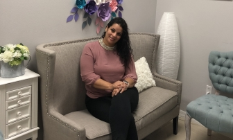 Ivette Rodriguez in the waiting room at Beyond Pregnancy Care Center in Kissimmee, Fla.