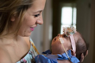 Hannah resisted pressure to abort her daughter, Evelyn - now a year old - after a Trisomy 18 diagnosis.