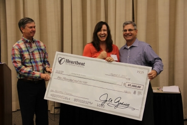 Kirk Walden (left) and Jor-El Godsey present $5,000 check to Mari Wingate for California pregnancy center.