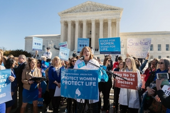 Dr. Christina Francis speaks at a rally for the oral arguments of the June Medical v. Gee case