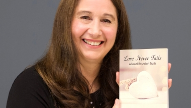 Ohio author Tesa Strasser with her book, Love Never Fails: A Novel Based on Truth